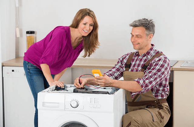 warwick appliance repairman with customer